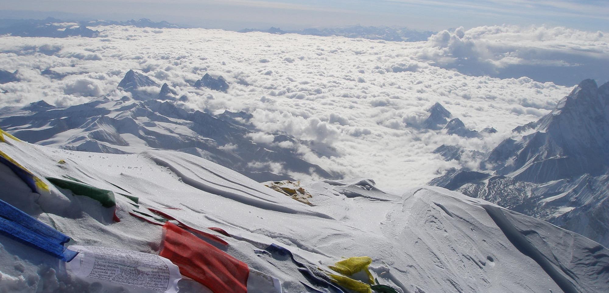 Prayer flags strewn on the summit of Mount Everest